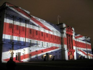Buckingham Palace with a Union Jack projected onto it. Photograph taken by Michael Reeve, 24 December 2003